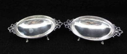 WILSON SHARP A PAIR OF VICTORIAN DESIGN SILVER BONBON DISHES of oval form with bow handles on four