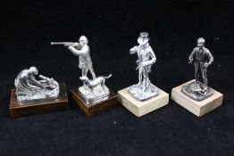 A COLLECTION OF FOUR CAST SILVER SPORTSMEN FIGURES; 'The Shot', 'The Squire', 'Dry Fly' and 'The