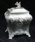 PIERRE GILLIOS AN EARLY GEORGE III SILVER TEA CANNISTER/CADDY of rectangular bombe form, repousse