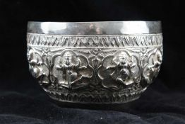 AN EARLY 20TH CENTURY SILVER THAI BOWL, embossed border of dancing figures / deities, 13cm in