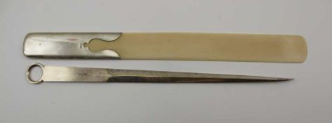 AN EARLY 20TH CENTURY SILVER HANDLED IVORY BLADED PAGE TURNER, London 1913, 32.5cm long, and a
