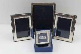 A COLLECTION OF FOUR SILVER MOUNTED PHOTOGRAPH FRAMES, to include one bound reed design to display