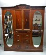 A LATE 19TH CENTURY INLAID MAHOGANY COMPACTUM WARDROBE, with two inlaid cupboard doors, over four