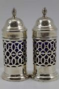 THE ALEXANDER CLARK MANUFACTURING CO.' A PAIR OF SILVER PEPPER POTS, of cylindrical form with