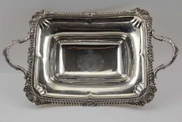 WILLIAM BURWASH A GEORGE III SILVER SERVING DISH, of oblong form, with two handles, gadrooned rim