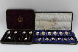JAMES SWANN & SON A CASED SET OF TWELVE SILVER TEASPOONS, with scallop shell terminals and barley