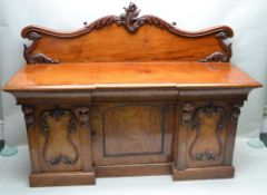 A LATE 19TH CENTURY MAHOGANY FINISHED SIDEBOARD with fancy carved and shaped upstand, having three