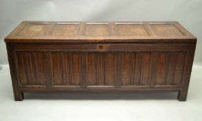 A LATE 17TH / EARLY 18TH CENTURY OAK COFFER, fitted five linen fold panels to the front, on stile