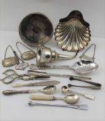 A SELECTION OF SILVER-PLATED ITEMS to include; a wine bottle coaster, a silver-plated scallop form