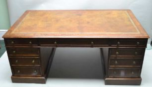A LATE 19TH CENTURY MAHOGANY PARTNER'S DESK, with tooled rectangular insert skiver, three inline