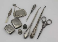 A LATE VICTORIAN SILVER VESTA CASE, Birmingham 1892, with chased decoration, together with a plain