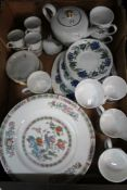 A BOX FULL OF DOMESTIC POTTERY to include a Susie Cooper blue floral decorated part tea service
