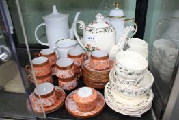 A HAND PAINTED EGGSHELL PORCELAIN JAPANESE COFFEE SET together with three pieces of white glaze