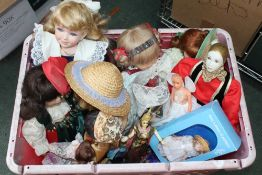 A LARGE CRATE CONTAINING A SELECTION OF DOLLS VARIOUS