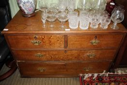A LATE 19TH CENTURY OAK FOUR DRAWER CHEST