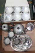 A BOX CONTAINING A HAMMERED PEWTER PART TEA SERVICE, silver-plated entre dishes, boxed set of six