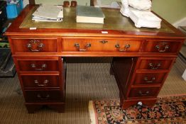 A REPRODUCTION DARK YEW WOOD FINISHED TWIN PEDESTAL DESK