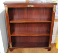 A PAIR OF CONTINENTAL DESIGN MAHOGANY OPEN FRONTED NARROW SETS OF SHELVES with decorative cast brass