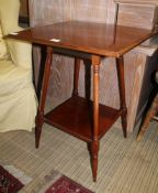 A LATE 19TH / EARLY 20TH CENTURY WALNUT SQUARE TOPPED OCCASIONAL TABLE on four turned and block