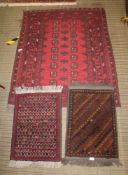 THREE WOVEN WOOLEN FLOOR RUGS, to include standard pigeon red ground hearth size, and two