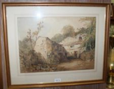 A 19TH CENTURY WATERCOLOUR STUDY OF A PROBABLE CONTINENTAL FARMSTEAD, with figure in the doorway,