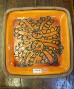 MARGERY CLINTON A STUDIO POTTERY TERRACOTTA DISH, glazed in volcanic orange with applied