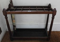 A FIRST-QUARTER 20TH CENTURY MAHOGANY FINISHED STICK STAND with multi-aperture top, supported on