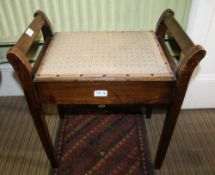 A STAINED BEECHWOOD PAD TOPPED PIANO STOOL, of typical form and construction