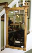 A PROBABLE 19TH CENTURY RECTANGULAR PLAIN PLATE WALL MIRROR in classical gilt coloured frame, with