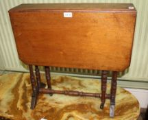 A LATE 19TH CENTURY MAHOGANY TWIN FLAP SMALL SIZED SUTHERLAND TABLE on ring turned supports