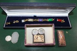 A BAG CONTAINING CHINESE METAL BRACELET set with coloured stones, together with other Chinese