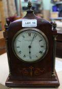 AN INLAID MAHOGANY CASED TIME PIECE, bearing the name 'Sir John Bennett Ltd, London'