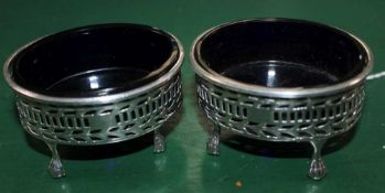 TWO HALLMARKED VICTORIAN SILVER SALTS with blue glass liners