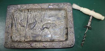 AN ORIENTAL PRESSED METAL TRAY in the form of two storks amongst the bamboo, together with a