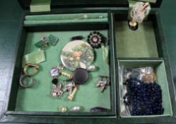 A GREEN FINISHED MUSICAL JEWELLERY BOX CONTAINING A SELECTION OF COSTUME JEWELLERY, together with
