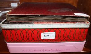 AN ALBUM AND TWO TIN BOXES CONTAINING A LARGE SELECTION OF COLLECTOR'S CIGARETTE / TEA CARDS