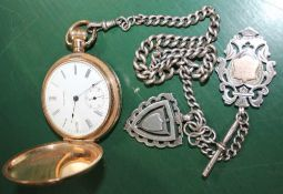 A GOLD PLATED POCKET WATCH together with a probable silver Albert with two shield fobs