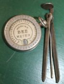 A METAL PIPE SMOKER'S ACCESSORY together with a Watkins Bee meter
