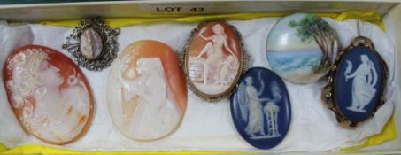 A BOX CONTAINING SIX CAMEOS and a small hand painted seascape, on a porcelain roundel