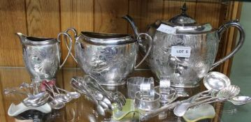 A FERN PATTERNED SILVER PLATED THREE-PIECE TEA SERVICE together with a series of boxed silver