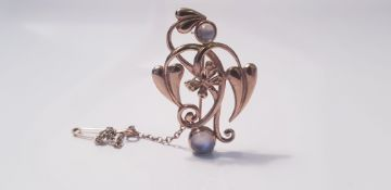 A 9ct yellow gold brooch of small butterfly, leaf and flower design, set with two moonstones,