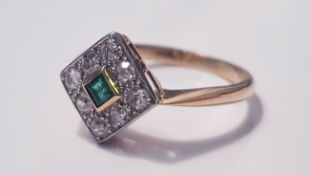 A yellow gold emerald and diamond cluster ring, marked 18ct, ring size M 1/2, approx. weight 1.