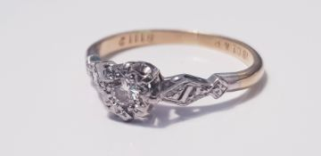 A 18ct yellow gold and platinum set single stone diamond ring, ring size J, approx. weight 2.0gms.