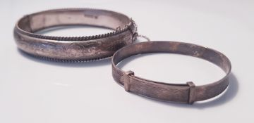 Two silver bangles. IMPORTANT: Online viewing and bidding only. No in person collections, an