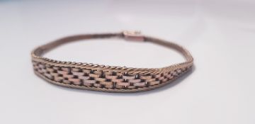 A 9ct tri-coloured gold patterned bracelet, approx. weight 9.9gms IMPORTANT: Online viewing and
