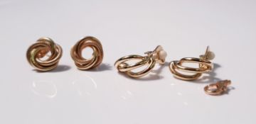 A pair of yellow gold marked 375 circular twist design stud earrings,approx.weight 2gms, and a