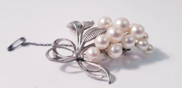 A Mikimoto pearl brooch, set with fifteen variously sized pearls, smallest measuring approx. 5.5mm