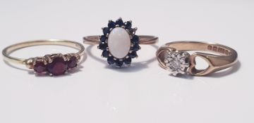 A 9ct yellow gold opal and sapphire cluster ring, (one sapphire missing), ring size L 1/2, approx.