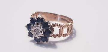 A 9ct yellow gold sapphire and diamond cluster ring set with 8 dark blue sapphires, ring size O,