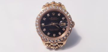 A Lady's Rolex diamond and 18k gold Oyster perpetual date just wristwatc date aperture to 3 o'clock,